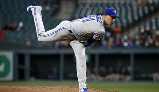 Toronto Blue Jays starting pitcher Aaron Sanchez follows through on a pitch to the Baltimore Orioles during the second inning of a baseball game Tuesday, April 10, 2018, in Baltimore. (AP Photo/Patrick Semansky)