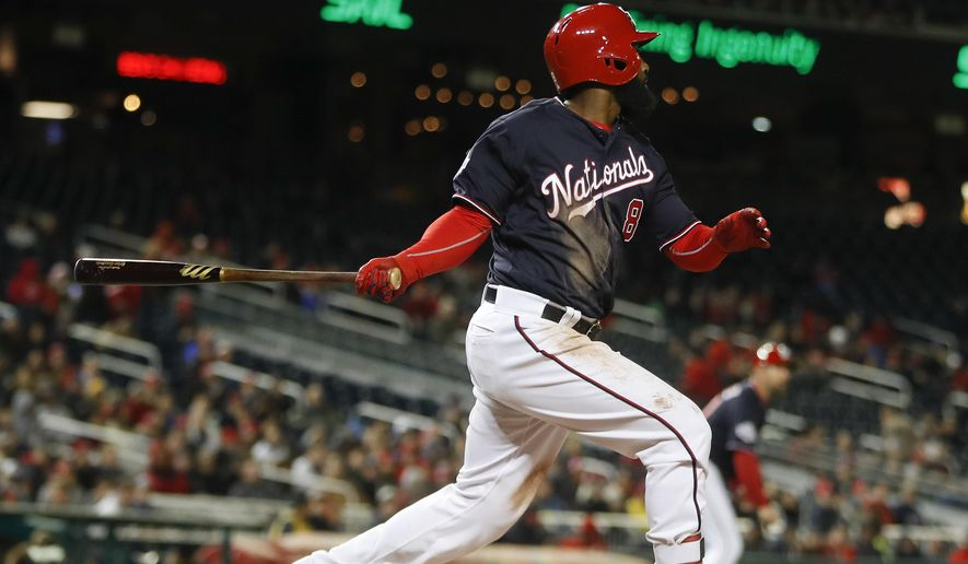Washington Nationals Brian Goodwin (8) hits an RBI single off Atlanta Braves starting pitcher Mike Foltynewicz (26) scoring Nationals' Wilmer Difo during the fourth inning of a baseball game at Nationals Park, Tuesday, April 10, 2018 in Washington. (AP Photo/Pablo Martinez Monsivais)