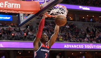 Washington Wizards guard John Wall dunks during the first half of the team's NBA basketball game against the Boston Celtics, Tuesday, April 10, 2018, in Washington. (AP Photo/Nick Wass)