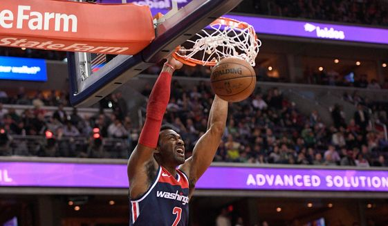 Washington Wizards Guard John Wall Dunks During The First Half Of Team39