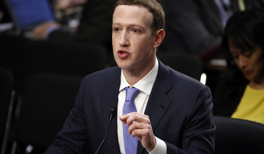 Facebook CEO Mark Zuckerberg testifies before a joint hearing of the Commerce and Judiciary Committees on Capitol Hill in Washington, Tuesday, April 10, 2018, about the use of Facebook data to target American voters in the 2016 election. (AP Photo, Alex Brandon)