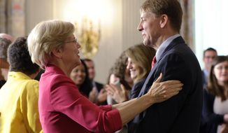FILE - In this July 17, 2013, file photo, Richard Cordray, right, the new director of the Consumer Financial Protection Bureau, talks with Sen. Elizabeth Warren, D-Mass., left, following a statement by President Barack Obama in the State Dining Room of the White House in Washington. Warren is coming to Ohio to campaign for Democratic gubernatorial candidate Cordray. (AP Photo/Susan Walsh, File)