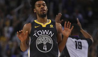 Golden State Warriors' Quinn Cook celebrates a score against the New Orleans Pelicans during the second half of an NBA basketball game Saturday, April 7, 2018, in Oakland, Calif. (AP Photo/Ben Margot)