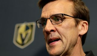 """FILE - In this June 19, 2017, file photo, Vegas Golden Knights General Manager George McPhee speaks during a news conference in Las Vegas. NHL executives, coaches and players are quick to say the game is played faster than ever. Technology is available to track how fast players are skating, how hard they're shooting and how quickly they're getting the puck from end to end. """"That's the next wave,"""" Vegas general manager McPhee acknowledged. As the expansion team prepares for the playoffs, McPhee was not interested in sharing any secrets. """"I don't tell people what we do,"""" McPhee said. (AP Photo/John Locher, File)"""