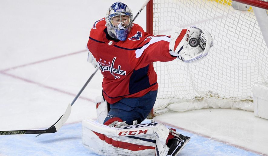 Washington Capitals goaltender Philipp Grubauer reaches for the puck during the third period of the team's NHL hockey game against the Nashville Predators, Thursday, April 5, 2018, in Washington. The Predators won 4-3. (AP Photo/Nick Wass) ** FILE **