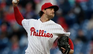Philadelphia Phillies starting pitcher Aaron Nola throws during the first inning of a baseball game against the Cincinnati Reds, Tuesday, April 10, 2018, in Philadelphia. (AP Photo/Laurence Kesterson)