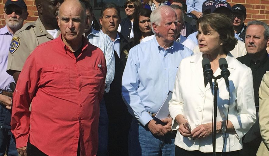 """FILE - In this Oct. 14, 2017 file photo, U.S. Sen. Dianne Feinstein, right, with California Gov. Jerry Brown, left, talks about the response to nearby fires during a news conference in Santa Rosa, Calif. Sen. Feinstein has won the endorsement of Gov. Brown in her bid for a fifth full term in Washington. Feinstein faces a challenge from state Sen. Kevin de Leon, a fellow Democrat who argues she is not standing up enough against President Donald Trump. But Brown, in his Tuesday, April 10, 2018, endorsement, says Feinstein is """"exactly the right person to ensure that Trump is held accountable."""" (AP Photo/Sudhin Thanawala, File)"""