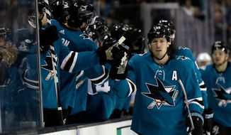 FILE - In this Tuesday, April 3, 2018, file photo, San Jose Sharks' Logan Couture celebrates his goal with teammates during the first period of an NHL hockey game against the Dallas Stars on, in San Jose, Calif. Couture had trouble performing simple tasks last postseason,  like eating and breathing, after his face was shattered by a puck. Having a healthy Couture will be key for the heading into the first round against Anaheim. (AP Photo/Marcio Jose Sanchez, File)
