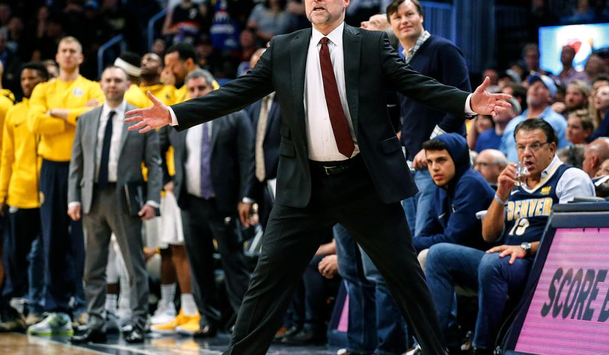Denver Nuggets head coach Michael Malone reacts to a call during the fourth quarter of an NBA ...