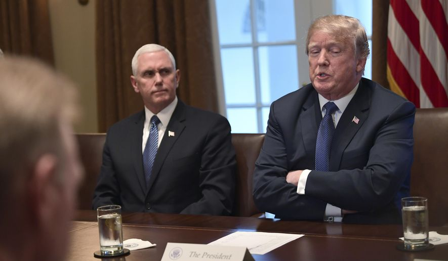 President Donald Trump, right, sitting next to Vice President Mike Pence, left, speaks in the Cabinet Room of the White House in Washington, Monday, April 9, 2018, at the start of a meeting with military leaders. (AP Photo/Susan Walsh)