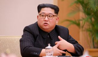 """In this April 9, 2018, photo provided by the North Korean government, North Korean leader Kim Jong Un attends a meeting of the Political Bureau of the Central Committee of the Workers' Party of Korea, in Pyongyang, North Korea. Independent journalists were not given access to cover the event depicted in this image distributed by the North Korean government. The content of this image is as provided and cannot be independently verified. Korean language watermark on image as provided by source reads: """"KCNA"""" which is the abbreviation for Korean Central News Agency. A U.S. university institute at the cutting edge of research on North Korea says the South Korean government has terminated its funding, forcing it to close after it rejected demands to change its leadership. (Korean Central News Agency/Korea News Service via AP)"""