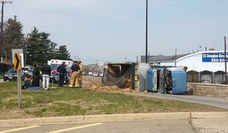 An overturned dump truck snarled traffic on New York Avenue snarled morning traffic. (photo: Ann Wog)