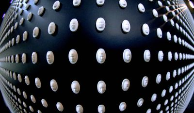 This image made with a fisheye lens, shows a portion of the 22,000 pills with faces carved into them on display in a memorial by the National Safety Council to the victims of the opioid epidemic at the University of Pittsburgh, Monday, Jan. 29, 2018, in Pittsburgh. The exhibit featuring the wall with the carved medicine pills, each representing the face of someone who fatally overdosed, was launched in Chicago in November, 2017. Pittsburgh is the first stop on a nationwide tour. (AP Photo/Keith Srakocic) (Associated Press)