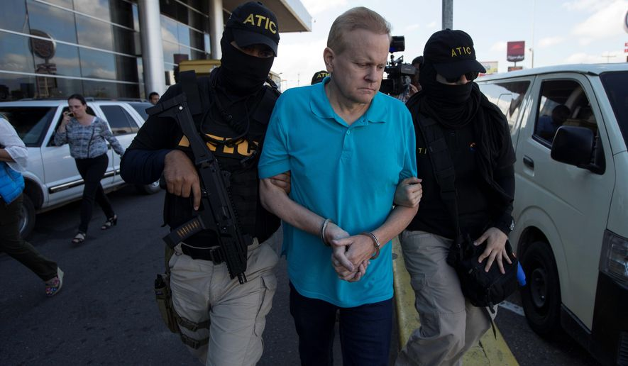 Eric Conn is escorted by SWAT team agents prior to his extradition, at the Toncontin International Airport, in Tegucigalpa, Honduras, Tuesday, Dec. 5, 2017. Conn, a fugitive Kentucky lawyer who escaped before facing sentencing for his central role in a massive Social Security fraud case, was captured as he came out of a restaurant in the coastal city of La Ceiba. (AP Photo/Moises Castillo) ** FILE **