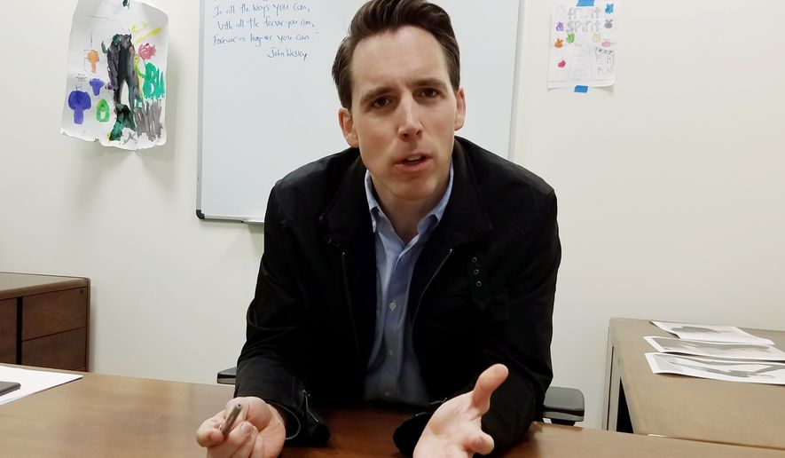 In this March 28, 2018 photo, Republican U.S. Senate candidate Josh Hawley, of Missouri, speaks at his Columbia, Mo., campaign office. Hawley is among the Republican Party's most-prized recruits, but things get complicated if you ask the Missouri Republican Senate candidate about President Donald Trump. Hawley supports the president's policies but sidesteps questions about his behavior. (AP Photo/Summer Ballentine)