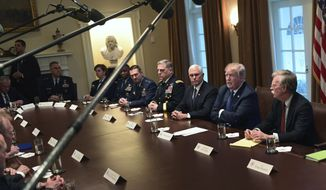 President Donald Trump, second from right, speaks in the Cabinet Room of the White House in Washington, Monday, April 9, 2018, at the start of a meeting with military leaders. Trump is flanked by Vice President Mike Pence, left, and national security adviser John Bolton, right. (AP Photo/Susan Walsh)