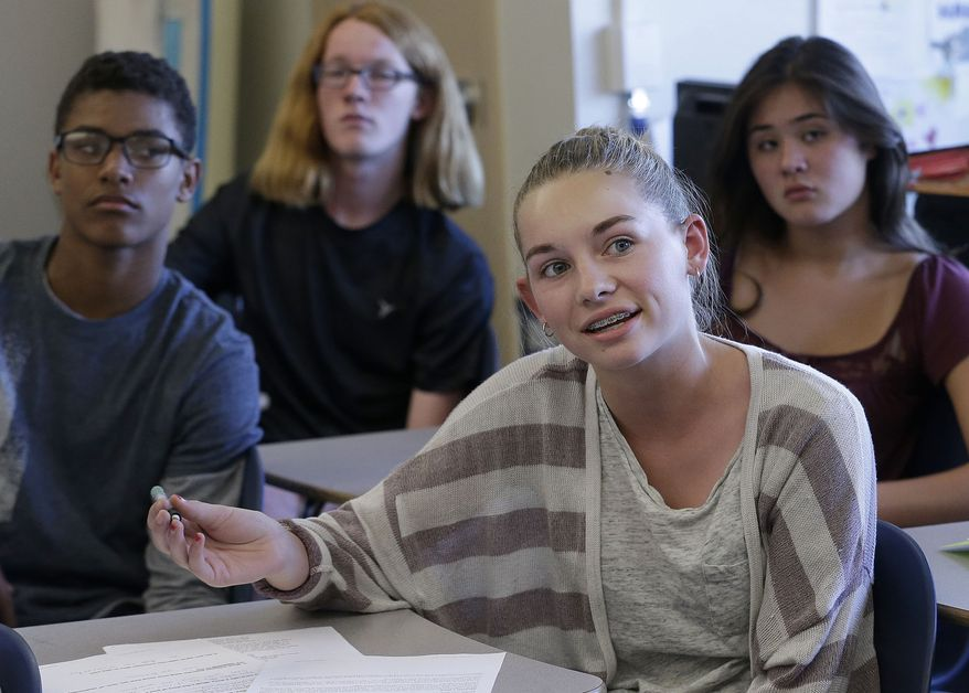 In this Oct. 8, 2015, photo, Audrey Crook, center, speaks during a ninth-grade Teen Talk High School class at Carlmont High School in Belmont, Calif. Sex education in some American high schools is evolving beyond pregnancy and disease prevention to include lessons aimed at curbing sexual assaults. (AP Photo/Jeff Chiu)