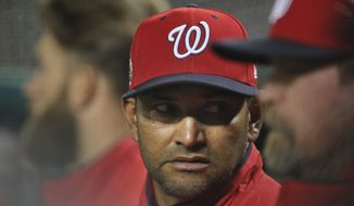 Washington Nationals manager Dave Martinez (4) in the dugout during a baseball game against the Atlanta Braves at Nationals Park, Tuesday, April 10, 2018 in Washington. Nationals won 4-1.(AP Photo/Pablo Martinez Monsivais)
