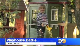 Zoe Adomeit, 3, walks outside a playhouse built by her father in Chino Hills, California. (Image: KCAL CBS-9 California screenshot)