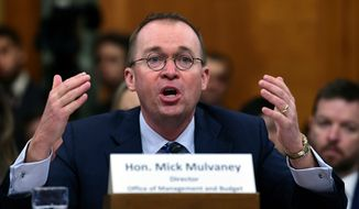 FILE- In this Feb. 13, 2018, file photo, Budget Director Mick Mulvaney testifies before the Senate Budget Committee on Capitol Hill in Washington. Mulvaney, acting director of the Consumer Financial Protection Agency, plans to testify before the House Financial Services Committee on Wednesday, April 11. (AP Photo/Susan Walsh, File)