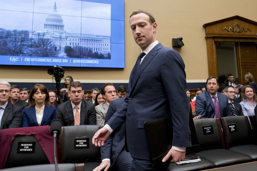 Facebook CEO Mark Zuckerberg arrives to testify before a House Energy and Commerce hearing on Capitol Hill in Washington, Wednesday, April 11, 2018, about the use of Facebook data to target American voters in the 2016 election and data privacy. (AP Photo/Andrew Harnik)