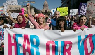 In this Saturday, Jan. 21, 2017, file photo, former Texas State Sen. Wendy Davis, center, dressed in all pink, leads the Women's March in Austin, Texas. (Ralph Barrera/Austin American-Statesman via AP) ** FILE **