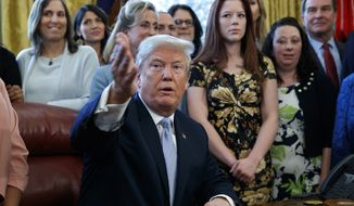 President Donald Trump speaks in the Oval Office at the White House before signing a new law aimed at curbing six trafficking Wednesday, April 11, 2018, in Washington. (AP Photo/Evan Vucci)