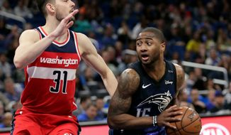 Orlando Magic's Rodney Purvis, right, looks for a way past Washington Wizards' Tomas Satoransky (31) during the second half of an NBA basketball game, Wednesday, April 11, 2018, in Orlando, Fla. (AP Photo/John Raoux)