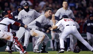 New York Yankees' Tyler Austin, center, rushes Boston Red Sox relief pitcher Joe Kelly, right, after being hit by a pitch during the seventh inning of a baseball game at Fenway Park in Boston, Wednesday, April 11, 2018. At left holding back Austin is Red Sox catcher Christian Vazquez. (AP Photo/Charles Krupa)