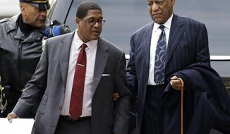 Bill Cosby, right, arrives for his sexual assault trial, Wednesday, April 11, 2018, at the Montgomery County Courthouse in Norristown, Pa. (AP Photo/Matt Slocum)