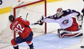 FILE - In this Dec. 2, 2017, file photo, Washington Capitals center Evgeny Kuznetsov (92), of Russia, scores a goal against Columbus Blue Jackets goalie Sergei Bobrovsky (72), also of Russia, during the third period of an NHL hockey game, in Washington.  Russian stars Alex Ovechkin, Evgeny Kuznetsov and Dmitry Orlov of the Capitals and Sergei Bobrovsky and Artemi Panarin of the Blue Jackets are expected to be difference-makers in what could be a tight series between Metropolitan Division-champion Washington and Columbus. (AP Photo/Nick Wass) ** FIE **