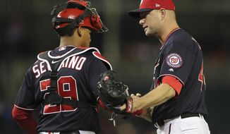Washington Nationals relief pitcher Ryan Madson (44) celebrates the final out with catcher Pedro Severino (29) at the end of a baseball game against the Atlanta Braves at Nationals Park, Tuesday, April 10, 2018 in Washington. Nationals won 4-1.(AP Photo/Pablo Martinez Monsivais)
