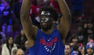Philadelphia 76ers' Joel Embiid wears mask while warming up for the team's NBA basketball game against the Milwaukee Bucks, Wednesday, April 11, 2018, in Philadelphia. (AP Photo/Chris Szagola)