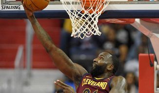FILE - In this Oct. 8, 2017, file photo, Cleveland Cavaliers center Kendrick Perkins, center, goes to the basket against the Washington Wizards during the second half of a preseason NBA basketball game in Washington. Veteran forward Kendrick Perkins is back with the Cavaliers. Cleveland signed Perkins on Wednesday, April 11, 2018, the final day of the regular season, and will have him on its playoff roster as the Cavs try to make the NBA Finals for the fourth straight year. (AP Photo/Nick Wass, File)
