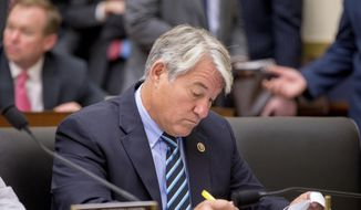 FILE - In this June 17, 2015, file photo, Rep. Dennis Ross, R-Fla., arrives to testify on Capitol Hill in Washington, before a House Financial Services committee hearing on the annual report of the Financial Stability Oversight Council. Ross announced Wednesday, April 11, 2018, that he will leave Congress after four terms. Ross said he plans to return to his Lakeland law practice. (AP Photo/Andrew Harnik, File)