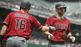 Arizona Diamondbacks' Paul Goldschmidt, right, is congratulated by Chris Owings (16) after hitting a home run off San Francisco Giants' Andrew Suarez in the inning fourth of a baseball game Wednesday, April 11, 2018, in San Francisco. (AP Photo/Ben Margot)