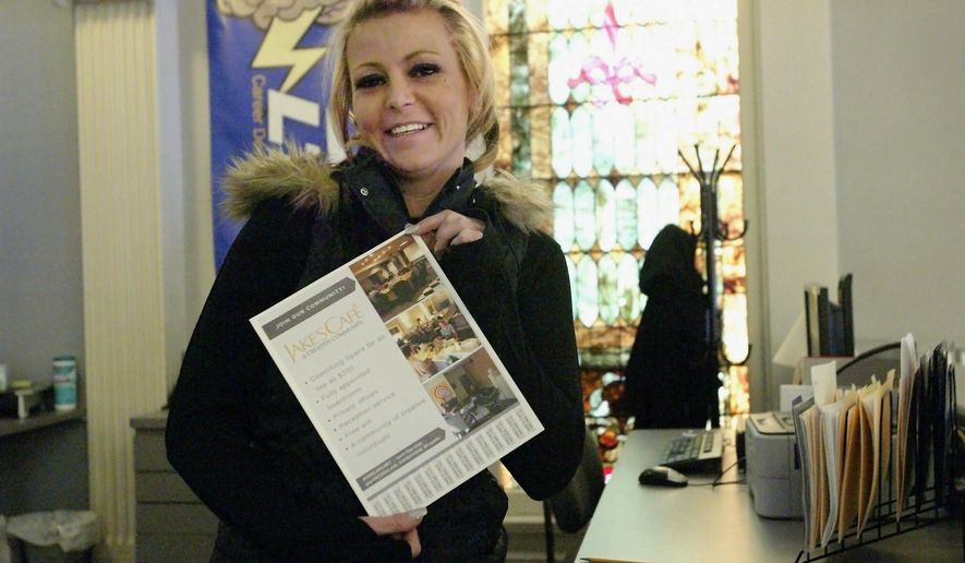 In this April 5, 2018, photo, Holly Pospichal holds a marketing piece as she did for Jake's Cafe, which currently houses over 30 businesses in Sheboygan, Wis. Pospichal is a business intern with Lakeshore Technical College in Cleveland, Wis. (Marina Affo/The Post-Crescent via AP)