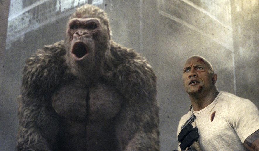 """This image released by Warner Bros. shows Dwayne Johnson in a scene from """"Rampage."""" (Warner Bros. via AP)"""