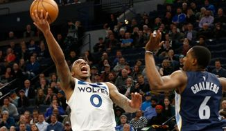 Minnesota Timberwolves' Jeff Teague lays the ball up as Memphis Grizzlies' Mario Chalmers, right, defends in the first half of an NBA basketball game Monday, April 9, 2018, in Minneapolis. (AP Photo/Jim Mone)