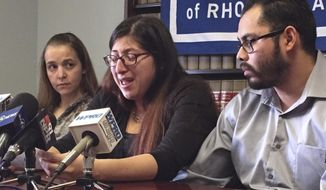 FILE - In this Feb. 14, 2018, file photo, Lilian Calderon, center, cries as she describes her experiences while in custody, alongside her husband, Luis Gordillo, right, during a news conference at the office of the American Civil Liberties Union in Providence, R.I. Calderon was detained by Immigration and Customs Enforcement after an interview designed to confirm her marital relationship. A judge stayed her deportation. The American Civil Liberties Union of Massachusetts filed class action lawsuit, which includes Calderon, Wednesday, April 11, against President Donald Trump over the government's practice of detaining immigrants married to U.S. citizens while they are trying to obtain lawful immigration status. (AP Photo/Michelle R. Smith, File)