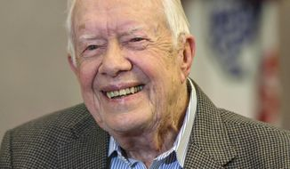 "Former President Jimmy Carter, 93, sits for an interview about his new book ""Faith: A Journey For All"" which will debut at no. 7 on the New York Times best sellers list, pictured before a book signing Wednesday, April 11, 2018, in Atlanta. (AP Photo/John Amis)"