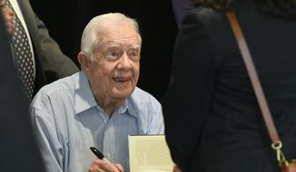 "Former President Jimmy Carter signs copies of his new book ""Faith: A Journey For All"" Wednesday, April 11, 2018, in Atlanta. (AP Photo/John Amis) ** FILE **"