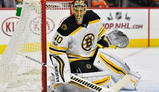 FILE - In this Dec. 2, 2017, file photo, Boston Bruins goalie Tuukka Rask looks for a loose puck during the second period of an NHL hockey game against the Philadelphia Flyers, in Philadelphia. Toronto goalie Frederik Andersen and Boston counterpart Tuukka Rask have near identical save percentages at .918 and .917, respectively.Game 1 of the Bruins and Toronto Maple Leafs first round playoff series is Thursday, April 12, 2018. (AP Photo/Derik Hamilton, File)