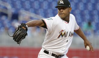 Miami Marlins starting pitcher Jarlin Garcia throws during the first inning of a baseball game against the New York Mets, Wednesday, April 11, 2018, in Miami. (AP Photo/Lynne Sladky)