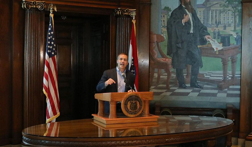 Missouri Gov. Eric Greitens speaks at a news conference about allegations related to his extramarital affair with his hairdresser, in Jefferson City, Mo., Wednesday, April 11, 2018. Greitens initiated a physically aggressive unwanted sexual encounter with his hairdresser and threatened to distribute a partially nude photo of her if she spoke about it, according to testimony from the woman released Wednesday by a House investigatory committee. (J.B. Forbes/St. Louis Post-Dispatch via AP)