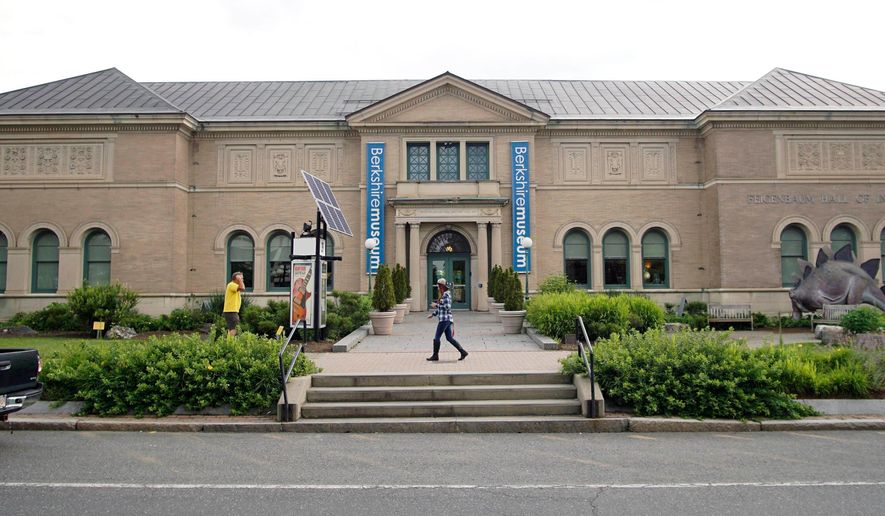 In this July 12, 2017 file photo, a pedestrian passes the Berkshire Museum in Pittsfield, Mass. Massachusetts museums are starting to reopen in July 2020 as the commonwealth gradually reopens.  (Ben Garver /The Berkshire Eagle via AP, File)