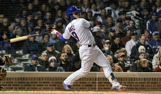 Chicago Cubs' Javier Baez (9) hits a three run home run against the Pittsburgh Pirates during the second inning of a baseball game on Wednesday, April 11, 2018, in Chicago. (AP Photo/Matt Marton)