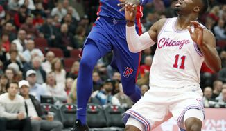 Detroit Pistons forward James Ennis III (33) goes in for a lay up past Chicago Bulls forward David Nwaba (11) during the first half of an NBA basketball game in Chicago, Wednesday, April 11, 2018. (AP Photo/Jeff Haynes)