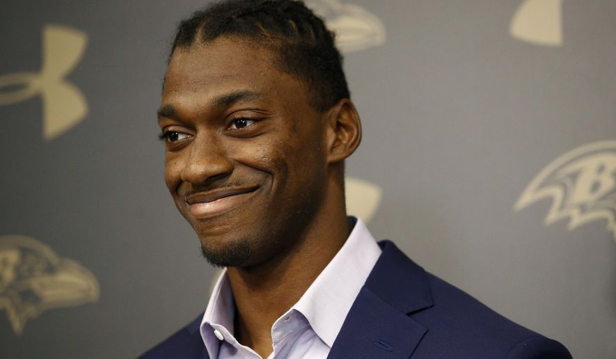 Newly-signed Baltimore Ravens backup quarterback Robert Griffin III speaks at an NFL football news conference at the team's headquarters in Owings Mills, Md., Wednesday, April 11, 2018. Griffin is returning to football after sitting out last season. (AP Photo/Patrick Semansky)