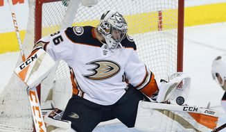 FILE - In this March 23, 2018, file photo, Anaheim Ducks goaltender John Gibson (36) makes a save against the Winnipeg Jets during the first period of an NHL hockey game in Winnipeg, Manitoba. The Ducks face the San Jose Sharks in the first round of the Stanley Cup playoffs. (John Woods/The Canadian Press via AP, File)